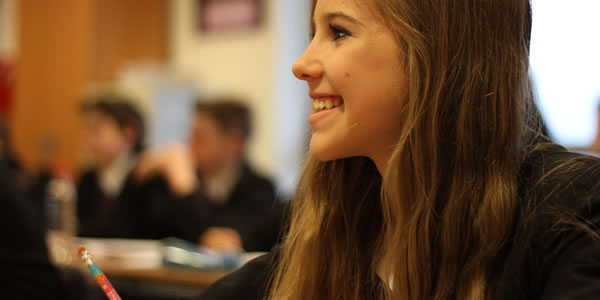 Smiling student in class